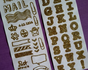 Two sheets of golden snailmail stickers