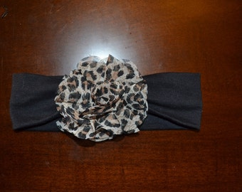Black stretchy headband with leopard flower