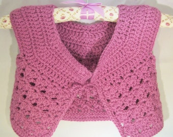 Girls Cardi-This cardi is crochet in a dusty rose color- acrylic yarn.The pattern design makes it so attractive & makes a great holiday gift