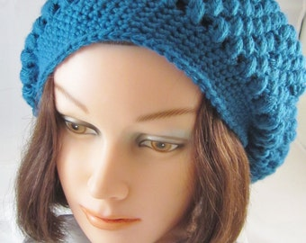 Hat-Woman's-This stylish woman's slouch hat is perfect for the winter ski season. It is crochet using a aqua blue acrylic yarn. A great gift