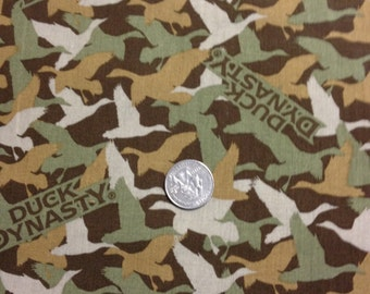 Duck dynasty camo with ducks in green,beige, dull gold, on brown background