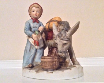 Woman with a Donkey Porcelain Figurine, Norleans.