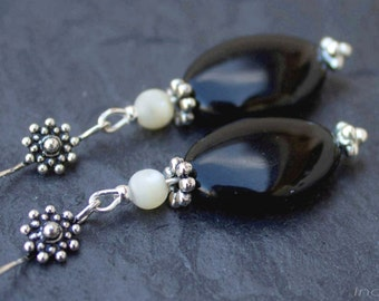 Sterling silver earrings with black glass and mother of pearl.