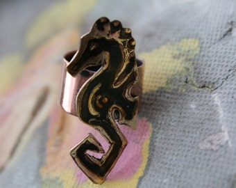 Hand etched seahorse ring made of copper and brass