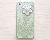 iphone 5, 5s smartphone case. Unique. Handmade. Rhinestones: green plant, purple. Flower charm. Transparent durable light green soft case.