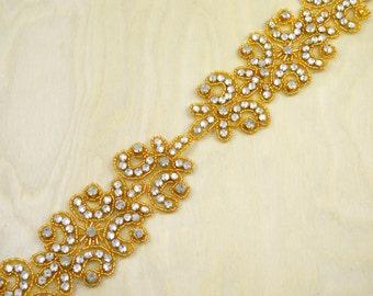 Tilda's Gold Rhinestone Applique Contemporary Art Deco Gold Rhinestone Appliqué with heat transfer backing.