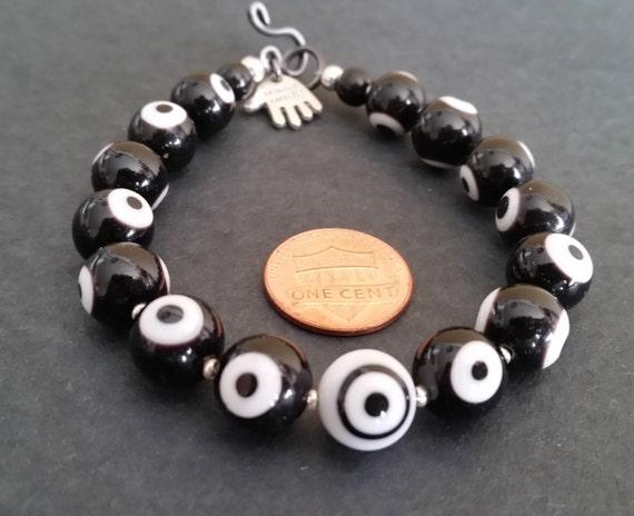 "EVIL EYE BEAD Bracelet with Black + White Glass Beads, Different Center. 7"" Wrist Size. Hook & Eye Clasp. Unisex. Bullseye Pattern Design."