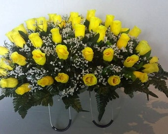 Large Memorial Saddle. Yellow rose buds/ white baby's breath and greenery on wire saddle