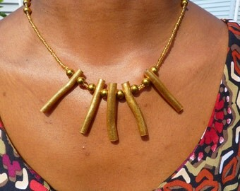 Gold statement necklace and earrings set