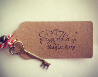 Santa's magic key with jingle bell kraft card tag stamped message and bakers twine