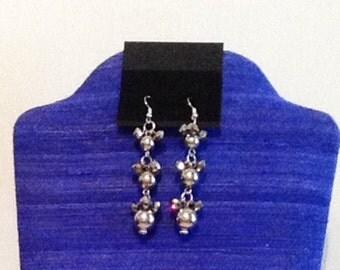 Silver beaded long earrings.