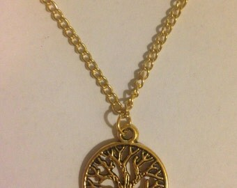 Tree of life gold charm on gold chain necklace