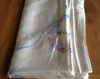 Cream Satin single bed spread. Pretty embroidered flowers in centre.