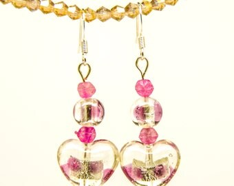 Heart-shaped glass beads with pink accents