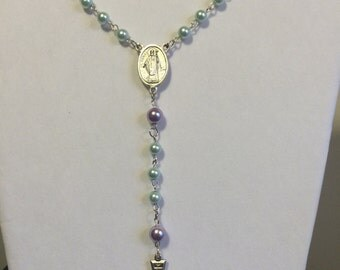 One of a kind Rosary made of glass pearl beads.