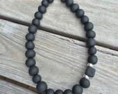 Black statement necklace. Big bold chunky bead design. Black necklace. Short necklace.