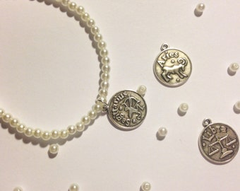 pearl bracelet. Zodiac sign charms