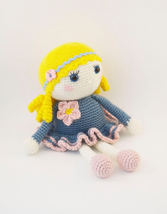 Amigurumi crochet doll Sweet little girl in a blue and pink