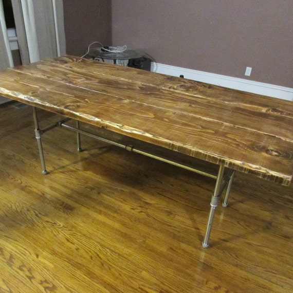 Rustic dining table with industrial steel pipe by for Rustic pipe table