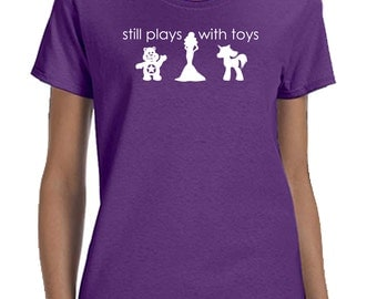 Still plays with toys , funny girls child at heart shirts t-shirt tee hoodie