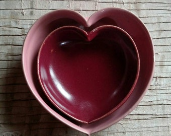nested red and pink pottery hearts
