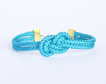 Electric blue infinity knot nautical rope bracelet with gold anchor charm