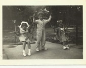 Vintage Funny Photo Kids Swinging Playing 30s Antique Black and White Photo Paper Ephemera Souvenir