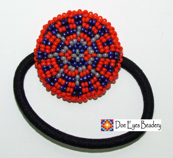 beaded ponytail holder orange spoked wheel free by