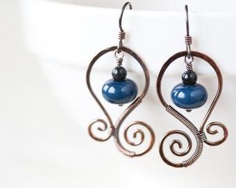 Dark denim blue earrings, oxidized hand forged copper spirals, handmade lampwork glass beads, steel blue lampwork earrings, neutral dangle
