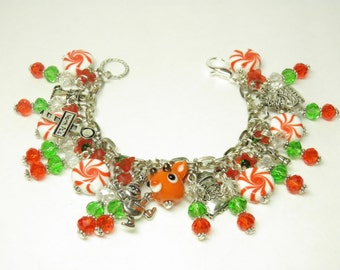 Christmas Bracelet, Rudolph the Red Nosed Reindeer Jewelry, Handcrafted Artisan Lampwork Rudolph and Christmas Candy Christmas Jewelry OOAK