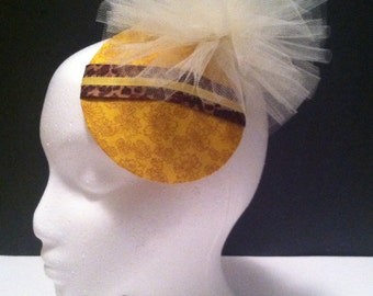 Stunning daffodil fascinator hat on a snap clip. Portion of sale goes to charity.