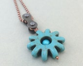 bicycle chain blue green sun shaped stone and glass necklace