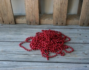 Two Strands of Red Plastic Bead Garland - 36 Feet Long