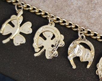 Vintage Charm Bracelet with Horses Horseshoes Wishbones and Four Leaf Clovers