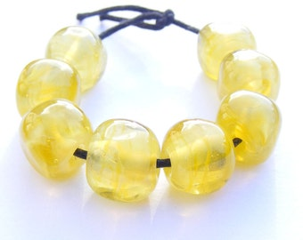 Pearly yellow handmade lampwork bead set of 8 curvy cube shaped glass beads