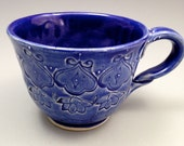 Blue stoneware mug with floral decoration