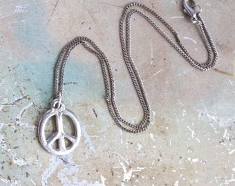 Peace on Earth Necklace - Symbol Pendant on Dark silver Chain