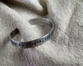Little by little one travels far:  hand stamped 3/8 inch aluminum Tolkien attributed quote cuff