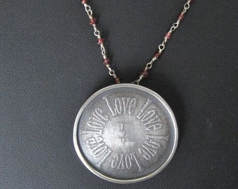 """Etched """"Love"""" pendant"""
