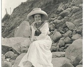 Old Photo Postcard Woman wearing Long White Dress  and Hat sitting on Rocks at Beach 1910s Photograph snapshot Azo Rppc vintage