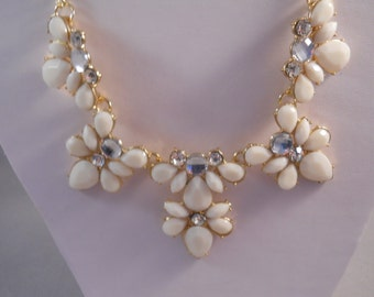 Gold Tone Necklace with White Petals and Rhinestone Pendants on a Gold Tone Chain