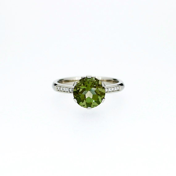 peridot solitaire engagement ring by torkkelijewellery