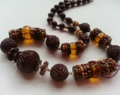 unique looking carved glass, wood and amber crystal beaded Genuine VINTAGE necklace