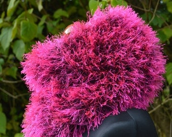 Fluffy cowl in neon pink with matching cuffs.