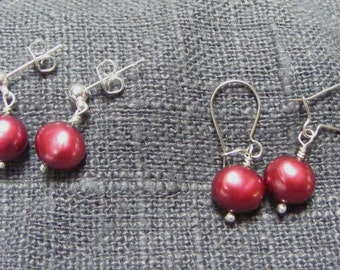 Red pearl earrings.