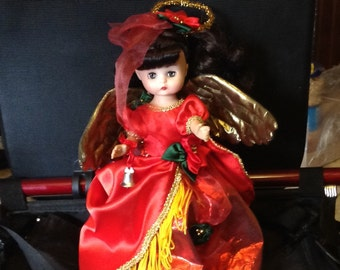 Adorable Treetop Angel by Effanbee 1988 dressed in beautiful red satiny dress