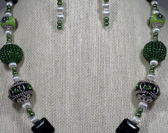 Green beaded necklace and earring set.