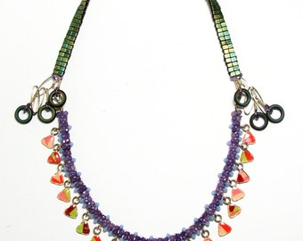 Necklace with genuine zircon and glass beads