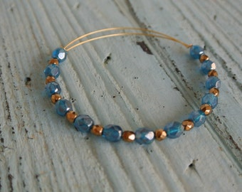Beaded bangle bracelet.  capri blue, bronze bracelet, beaded bracelet, beach bracelet