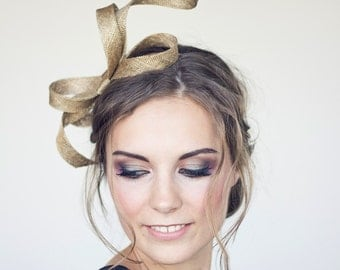 Modern fascinator , gold fascinator, serpentine shape fascinator, sinamay bow, headpiece, gold headpiece
